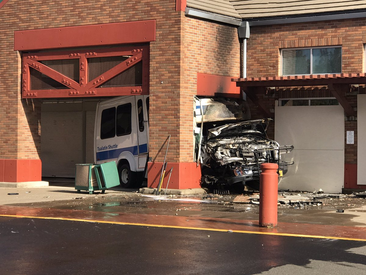 A shuttle bus crashed under an overhang at a shopping center in Tualatin on Friday, August 25, 2017. (SBG photo)