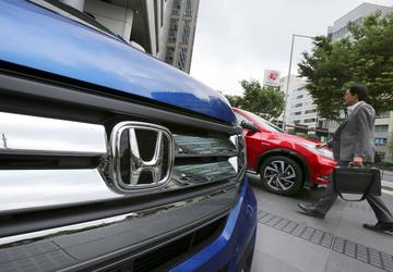 Honda profit slips on air-bag woes despite sales growth