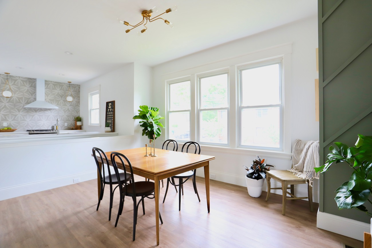 Although she initially wanted to keep the original hardwood floors, they unfortunately didn't have another layer of sanding left in them, so they installed all-new luxury vinyl plank flooring throughout the first floor instead. / Image courtesy of Nicole Nichols // Published: 6.2.20