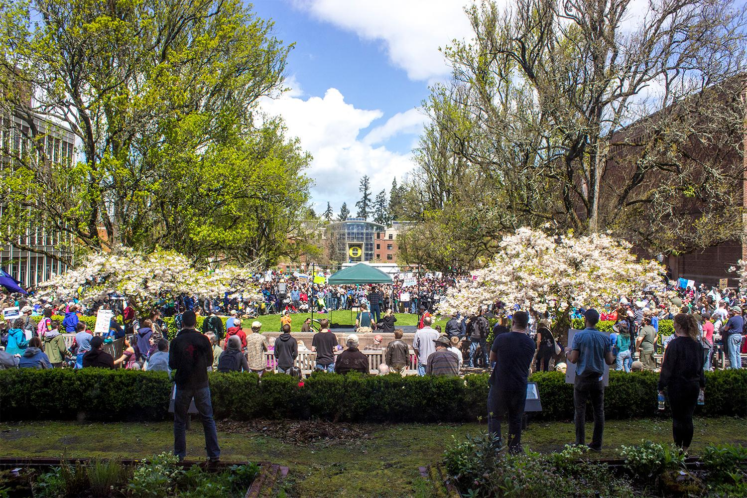 Hundreds of people gathered on the University of Oregon campus and marched to the Federal Court House on Earth Day, April 22, 2017. The crowd joined protests around the country against the Trump administration's proposed cuts to scientific research and the Environmental Protection Agency. Photo by Amanda Butt