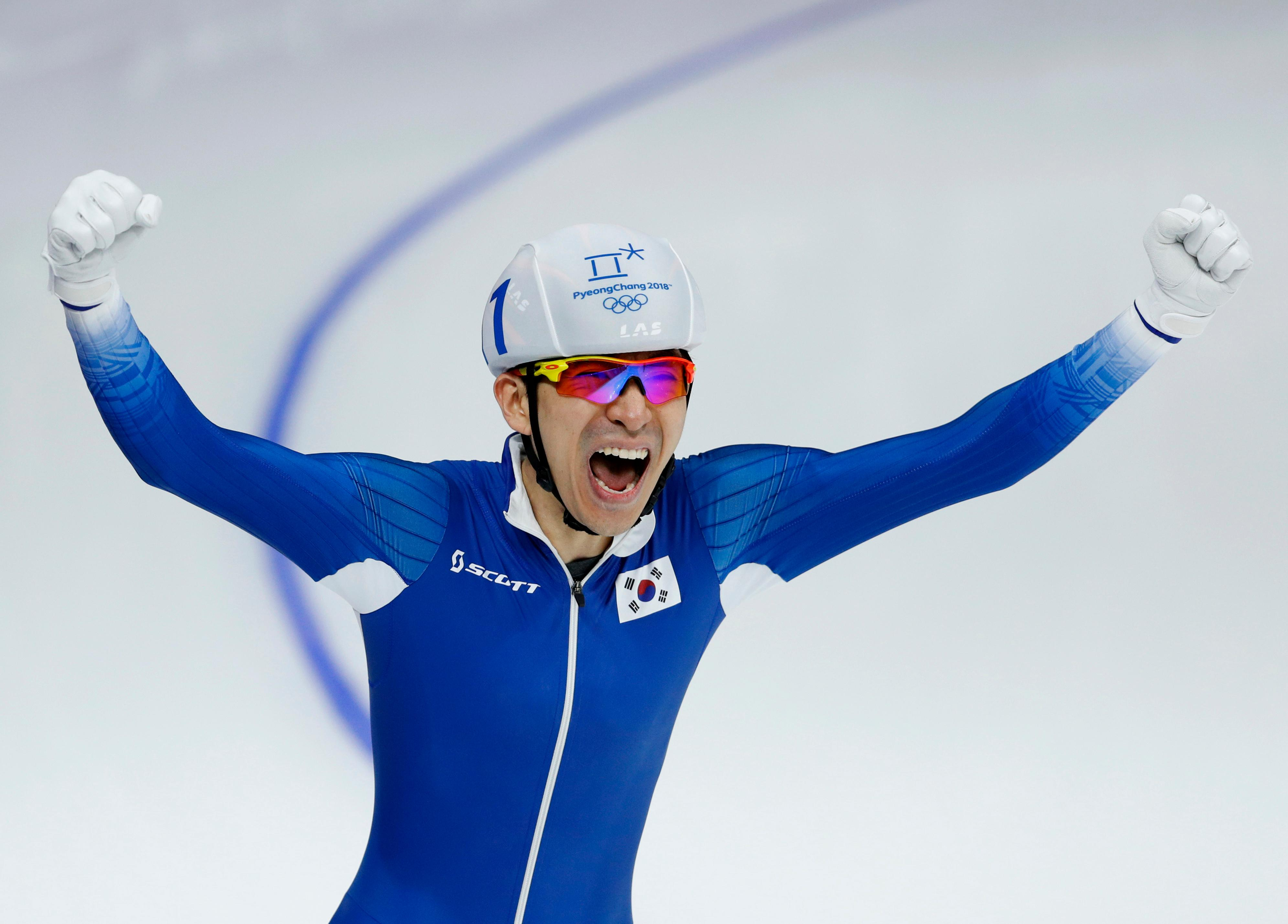 Gold medalist Lee Seung-hoon of South Korea celebrates after the men's mass start final speedskating race at the Gangneung Oval at the 2018 Winter Olympics in Gangneung, South Korea, Saturday, Feb. 24, 2018. (AP Photo/John Locher)