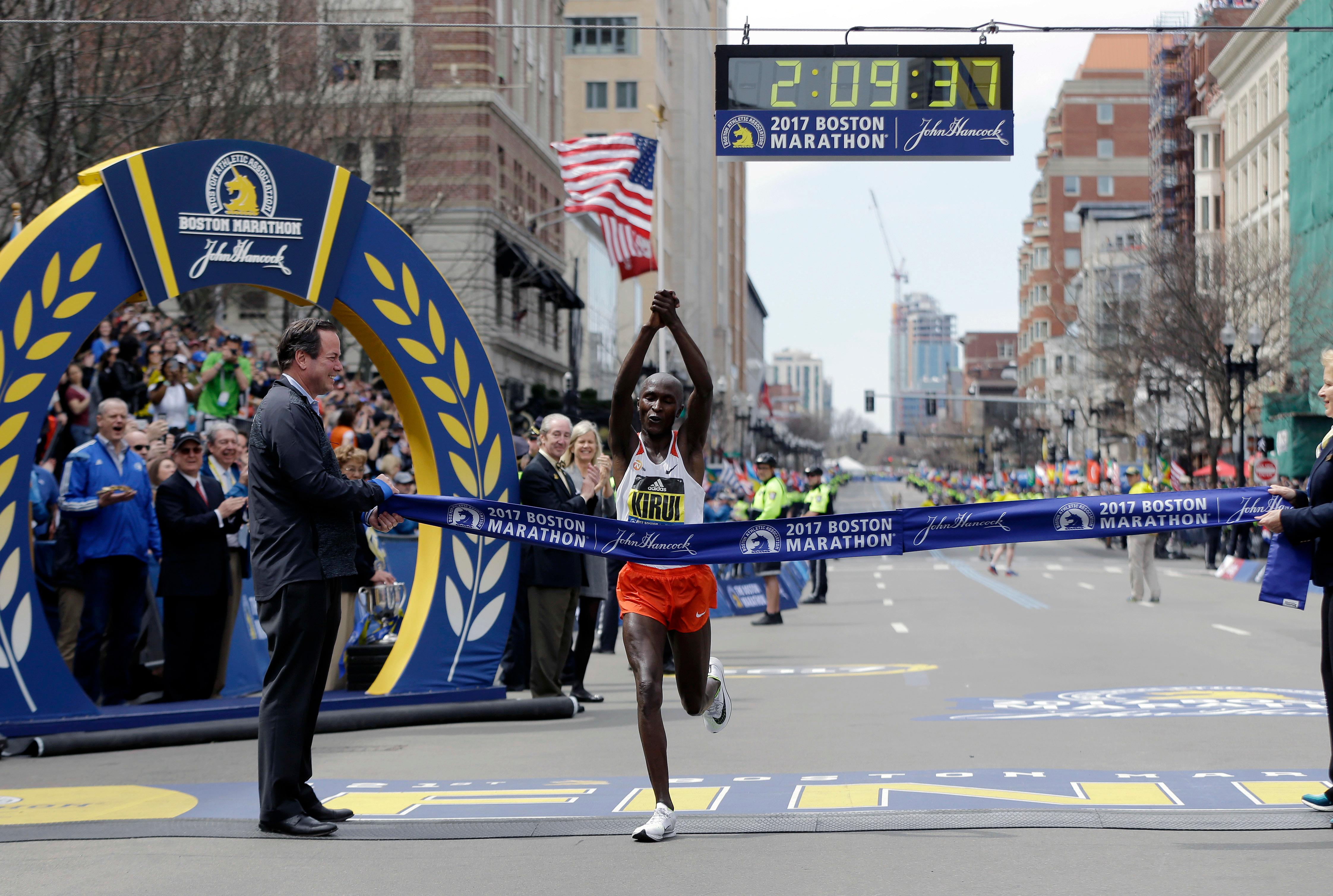 Geoffrey Kirui, of Kenya, crosses the finish line to win the 121st Boston Marathon on Monday, April 17, 2017, in Boston. (AP Photo/Elise Amendola)