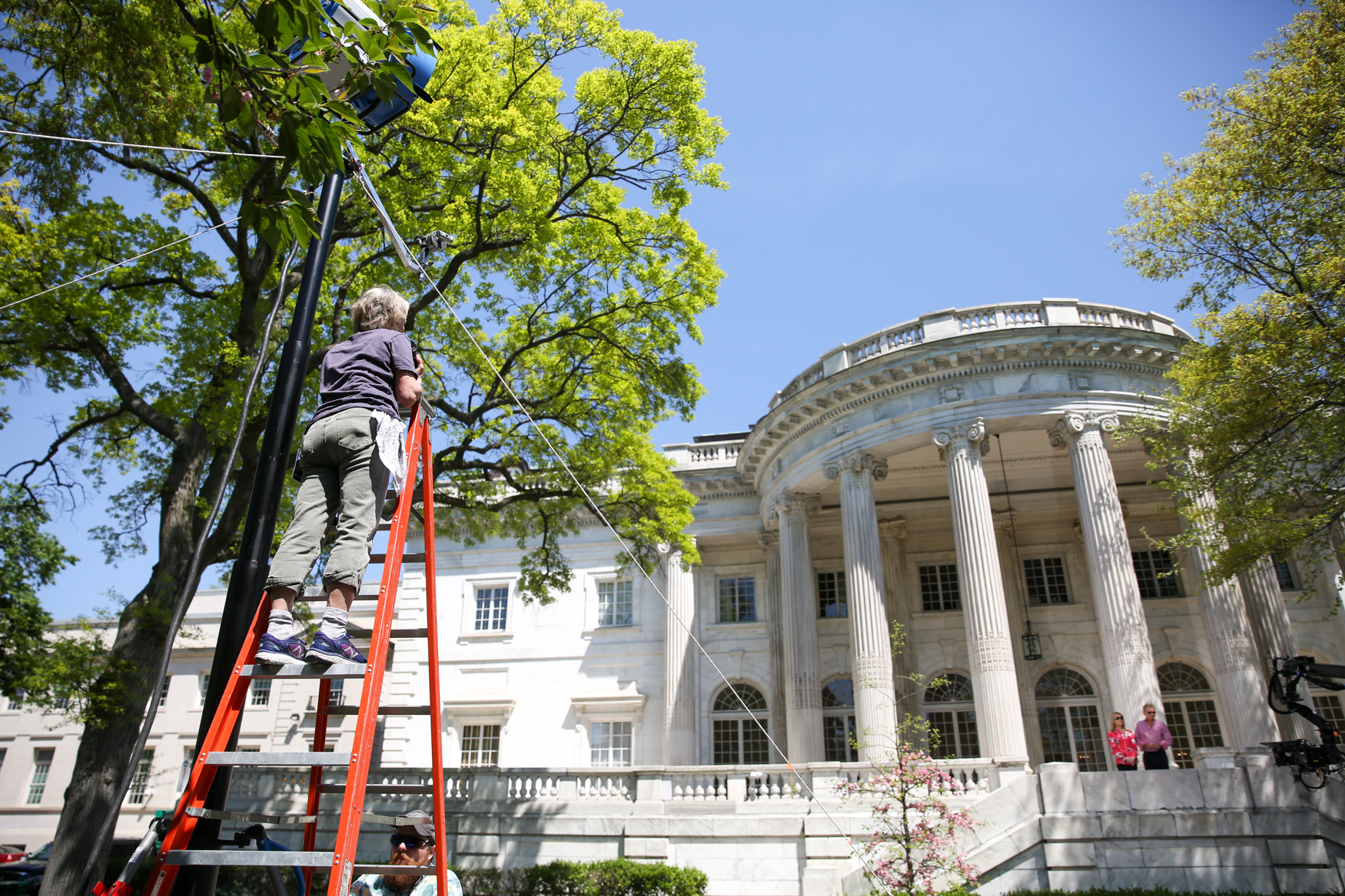 A photographer waits for the perfect shot during a promotion taping at DAR Hall.{ }(Photo by DC Refined)