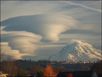 Photo of Lenticular clouds over Mt. Rainier, taken Dec. 5, 2008 by Tim Thompson.
