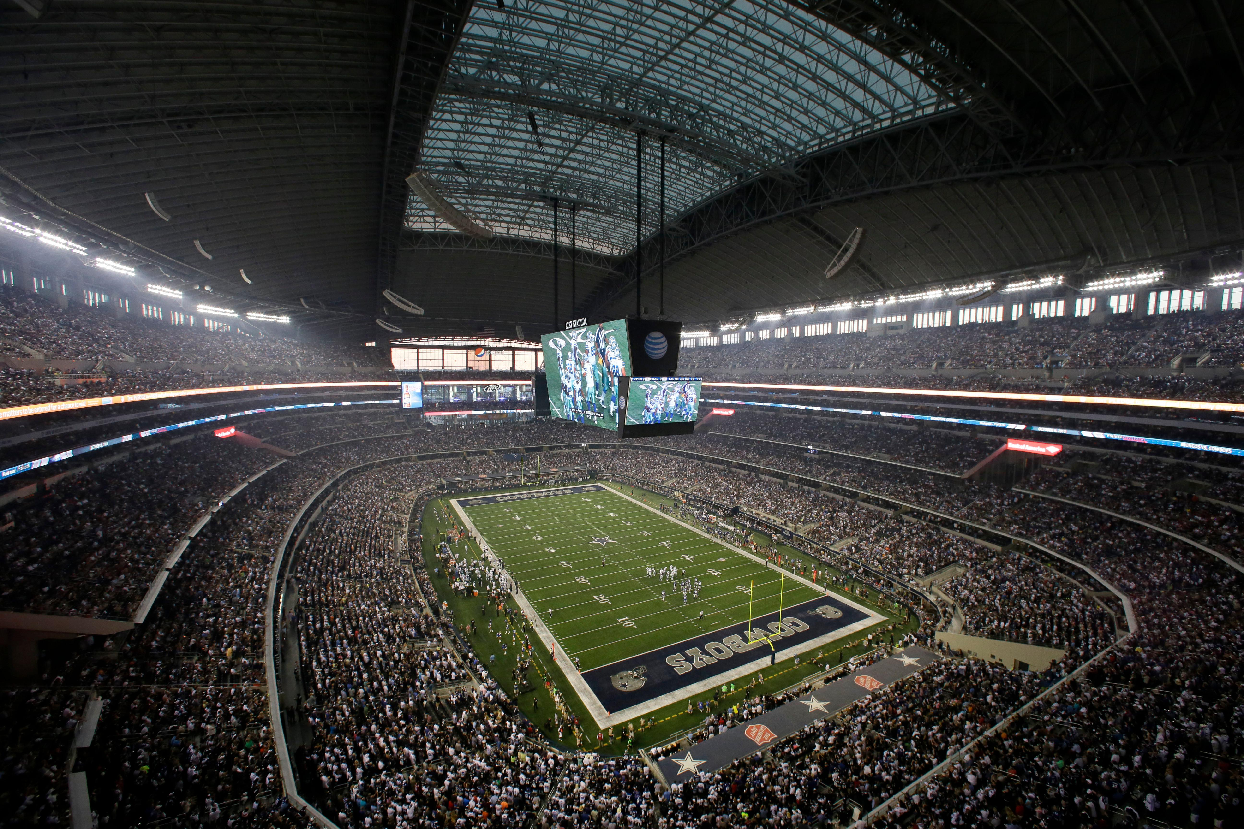 FILE - In this Sept. 8, 2013, file photo, fans watch at the start of an NFL football game between the New York Giants and Dallas Cowboys, in Arlington, Texas. (AP Photo/Tony Gutierrez, File)