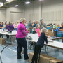 Hundreds help pack meals Friday night to fight hunger around the world
