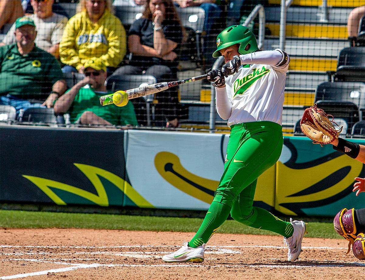 The Duck's Shannon Rhodes (#9) connects with the ball. The Oregon Ducks Softball team took their third win over the Arizona Sun Devils, 1-0, in the final game of the weekends series that saw the game go into an eighth inning before the Duck?s Mia Camuso (#7) scored a hit allowing teammate Haley Cruse (#26) to run into home plate for a point. The Ducks are now 33-0 this season and will next play a double header against Portland State on Tuesday, April 4 at Jane Sanders Stadium. Photo by August Frank, Oregon News Lab