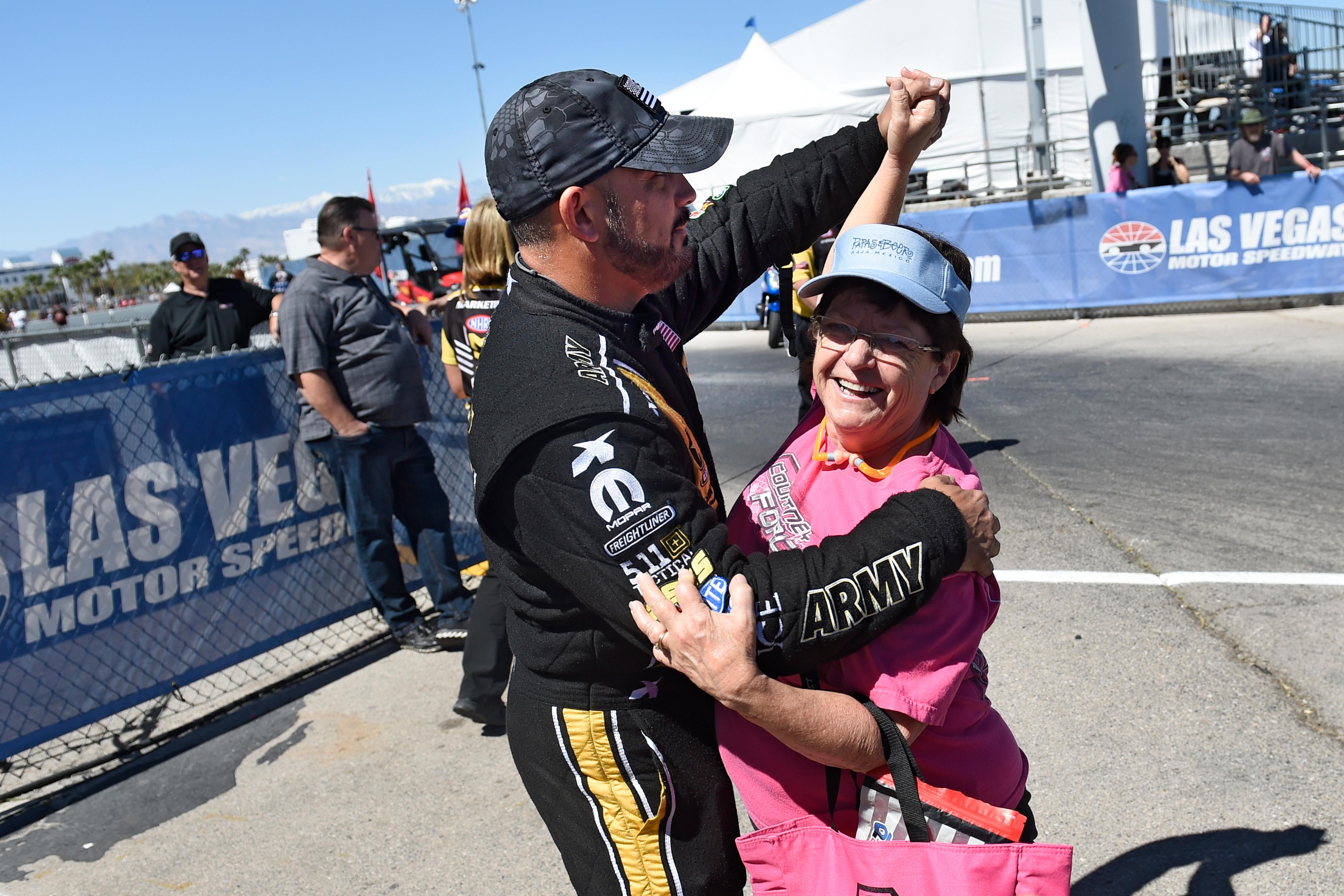 Top fuel driver Tony Schumacher dances with a fan during driver introductions at the NHRA DENSO Spark Plug Nationals at The Strip at the Las Vegas Motor Speedway Sunday, April 2, 2017. (Sam Morris/Las Vegas News Bureau)