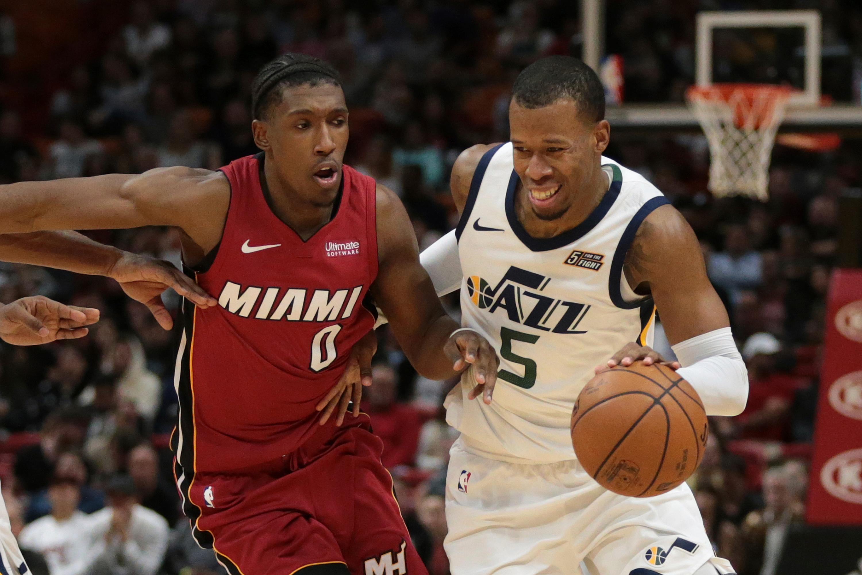 Utah Jazz guard Rodney Hood (5) dribbles against Miami Heat guard Josh Richardson (0) during the second half of an NBA basketball game, Sunday, Jan. 7, 2018, in Miami. (AP Photo/Joel Auerbach)