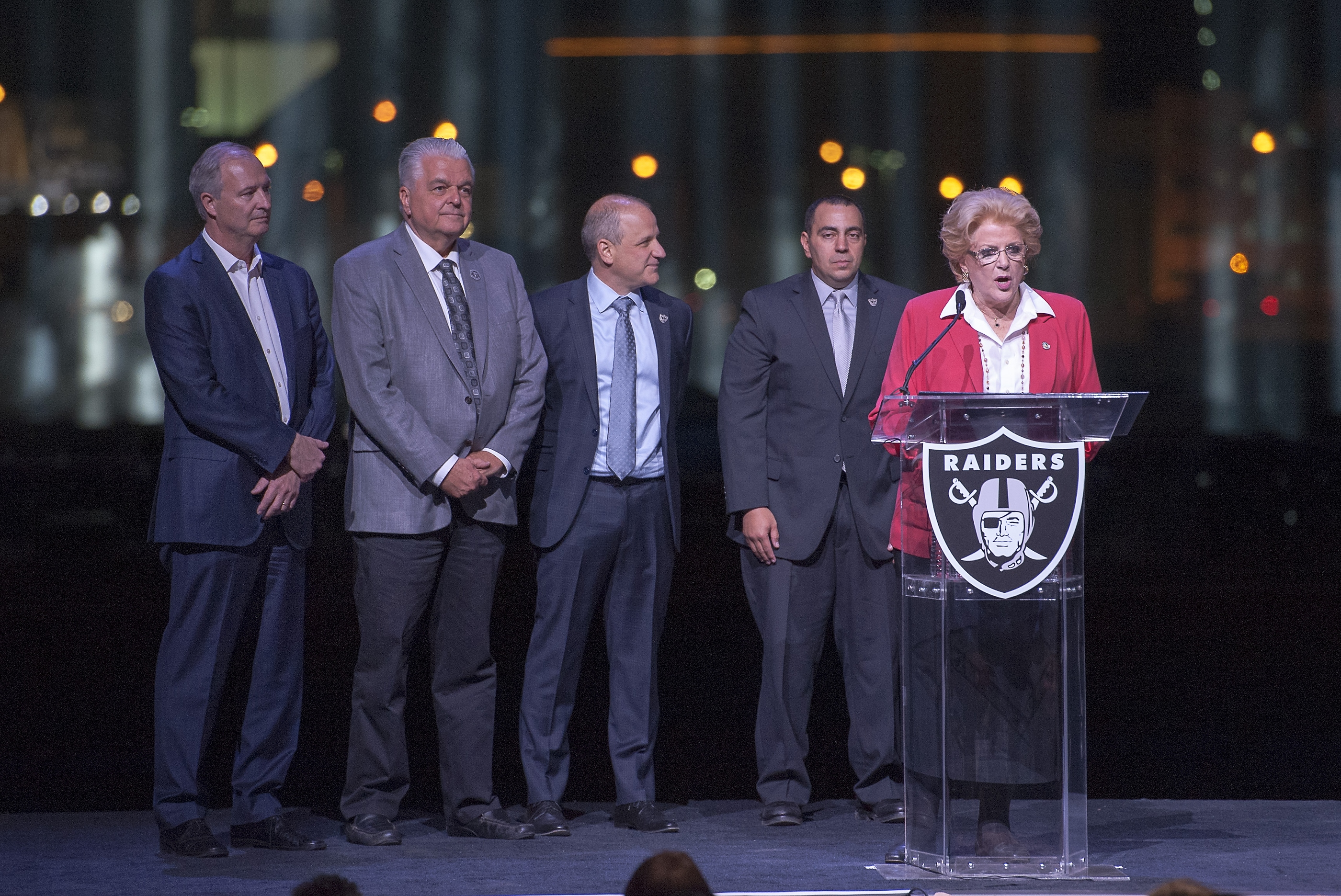 Las Vegas Masyor Carolyn G. Goodman, right, speaks at the groundbreaking ceremony for the Raiders Las Vegas Stadium at the Polaris Avenue site in Las Vegas on Monday, Nov. 13, 2017. Also on stage, from left, are Steve Hill, executive  director of the Nevada Governor's Office of Economic Development, Clark County Commissioner Steve Sisolak, Oakland Raiders President Marc Badain, and Oakland Raiders Legal Counsel Dan Ventrelle. CREDIT: Mark Damon/Las Vegas News Bureau