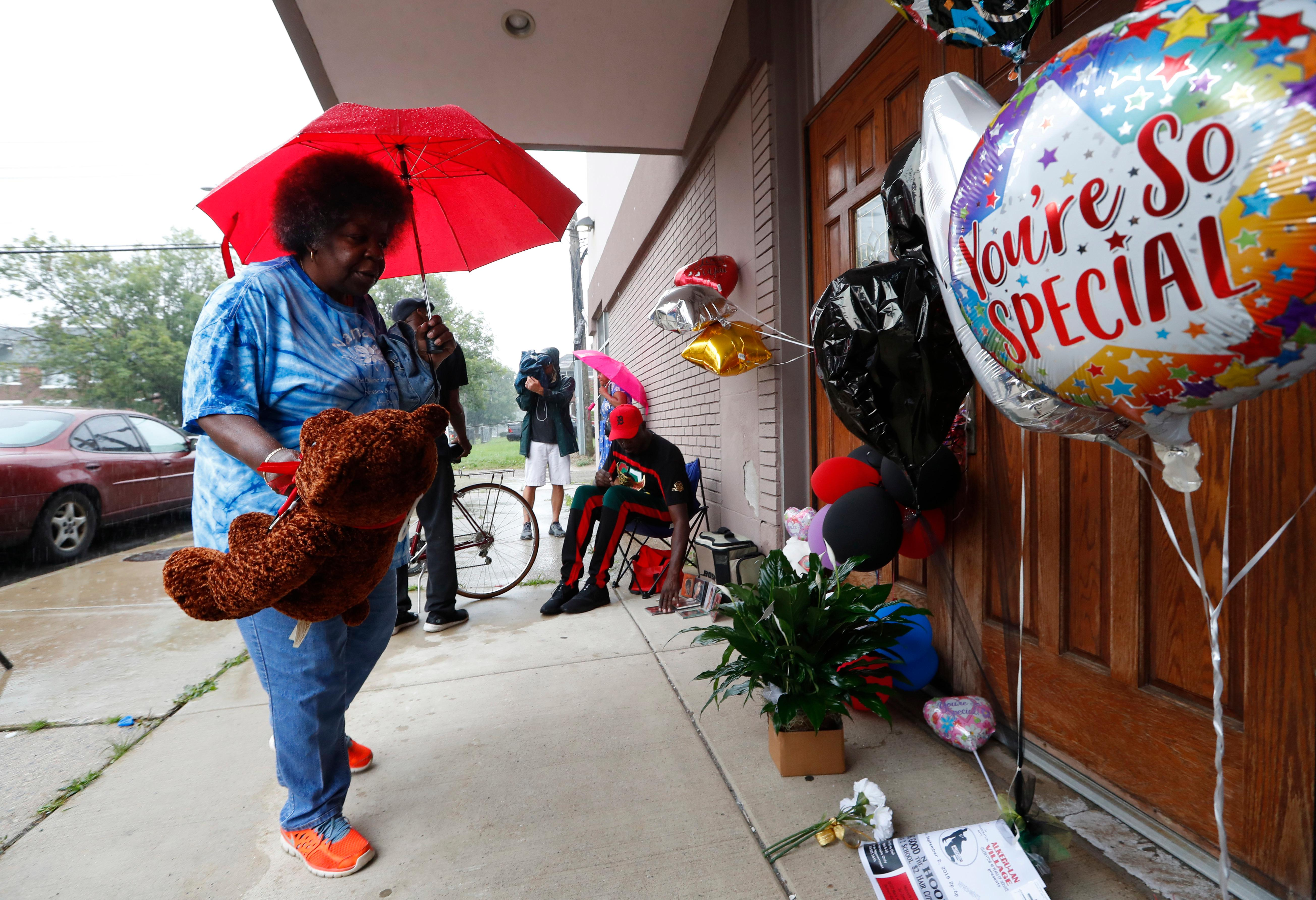 "Beverly Thompson leaves a stuffed bear outside at New Bethel Baptist Church in Detroit, Thursday, Aug. 16, 2018. Aretha Franklin, the undisputed ""Queen of Soul"" who sang with matchless style on such classics as ""Think,"" ''I Say a Little Prayer"" and her signature song, ""Respect,"" and stood as a cultural icon around the globe, died Thursday at age 76 from pancreatic cancer. C.L. Franklin, her father, had been pastor at the church that Franklin learned the gospel fundamentals that would make her a soul institution. (AP Photo/Paul Sancya)"
