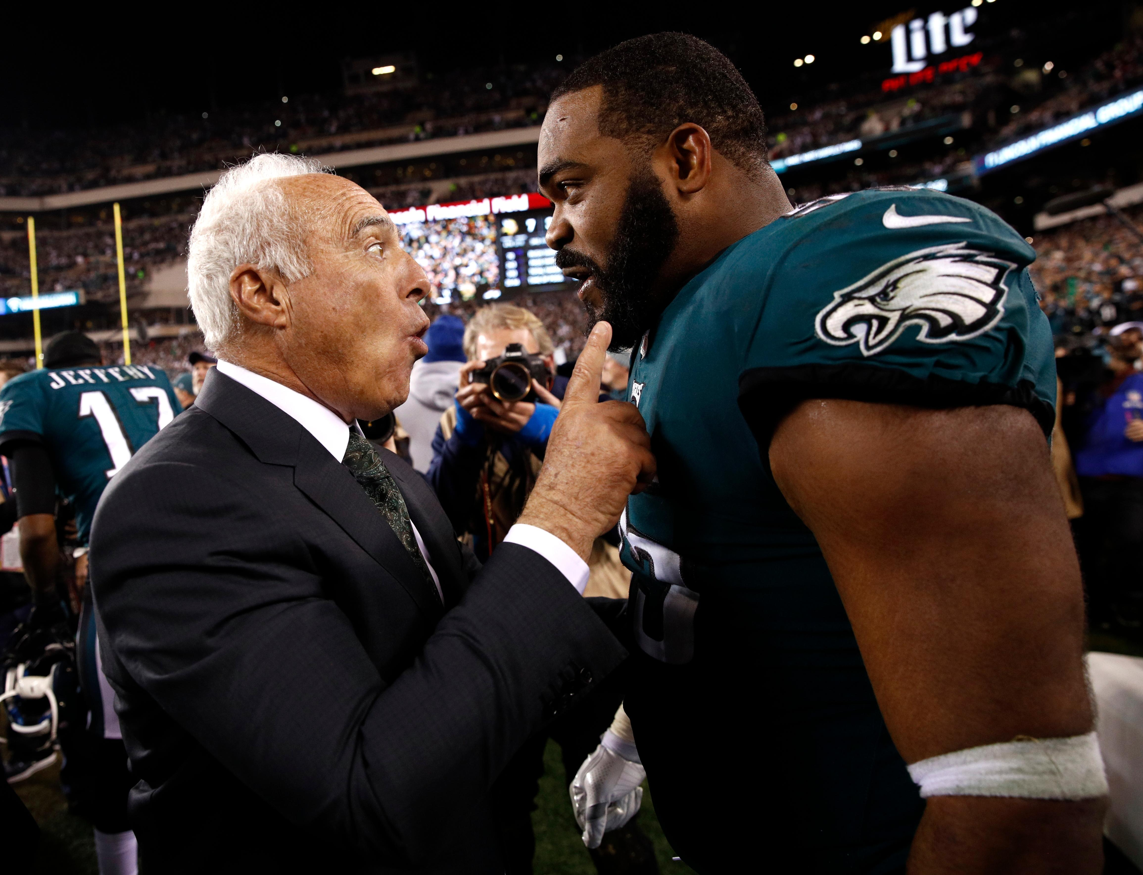 Philadelphia Eagles owner Jeffrey Lurie celebrates with Brandon Graham after the NFL football NFC championship game against the Minnesota Vikings Sunday, Jan. 21, 2018, in Philadelphia. The Eagles won 38-7 to advance to Super Bowl LII. (AP Photo/Patrick Semansky)
