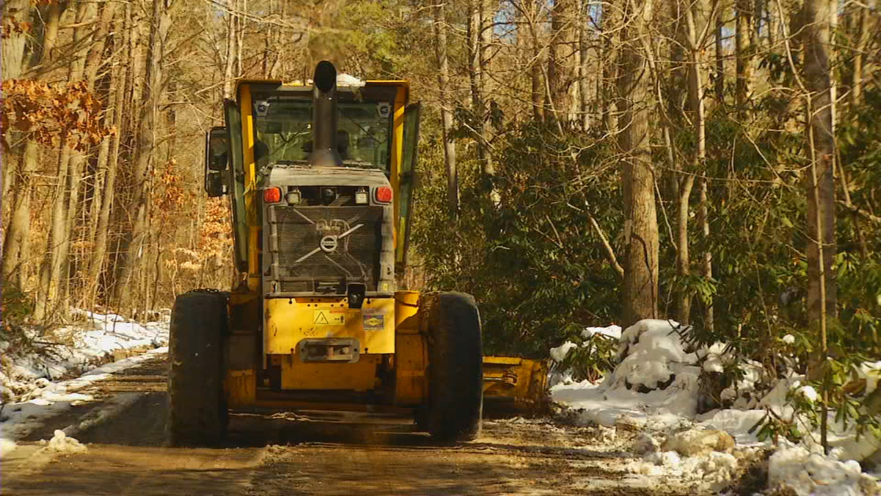 After several inches of snow was dumped across the mountains on Friday, Monday's sunshine worked to dry major interstates and highways. It gave the state's Department of Transportation a chance to turn its attention to the secondary roads that lead to many mountain neighborhoods. (Photo credit: WLOS Staff)