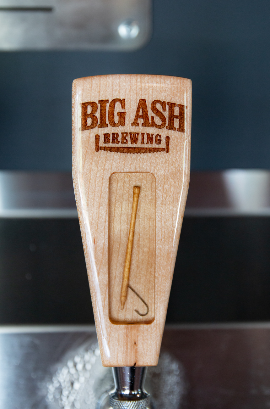 Every tap featuring a Big Ash brew has a different miniature logging tool embedded into it. / Image: Elizabeth A. Lowry // Published: 9.25.19
