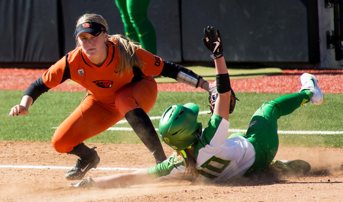 Oregon left fielder Alexis Mack (#10) slides into third base as Oregon State third basemen Sammi Noland (#6) looks for the ball. The Oregon Ducks defeated the Oregon State Beavers seven to zero on Sunday, April 30, 2017. The Ducks' victory marked the third victory of the three game sweep against the Beavers. Photo by Ben Lonergan, Oregon News Lab