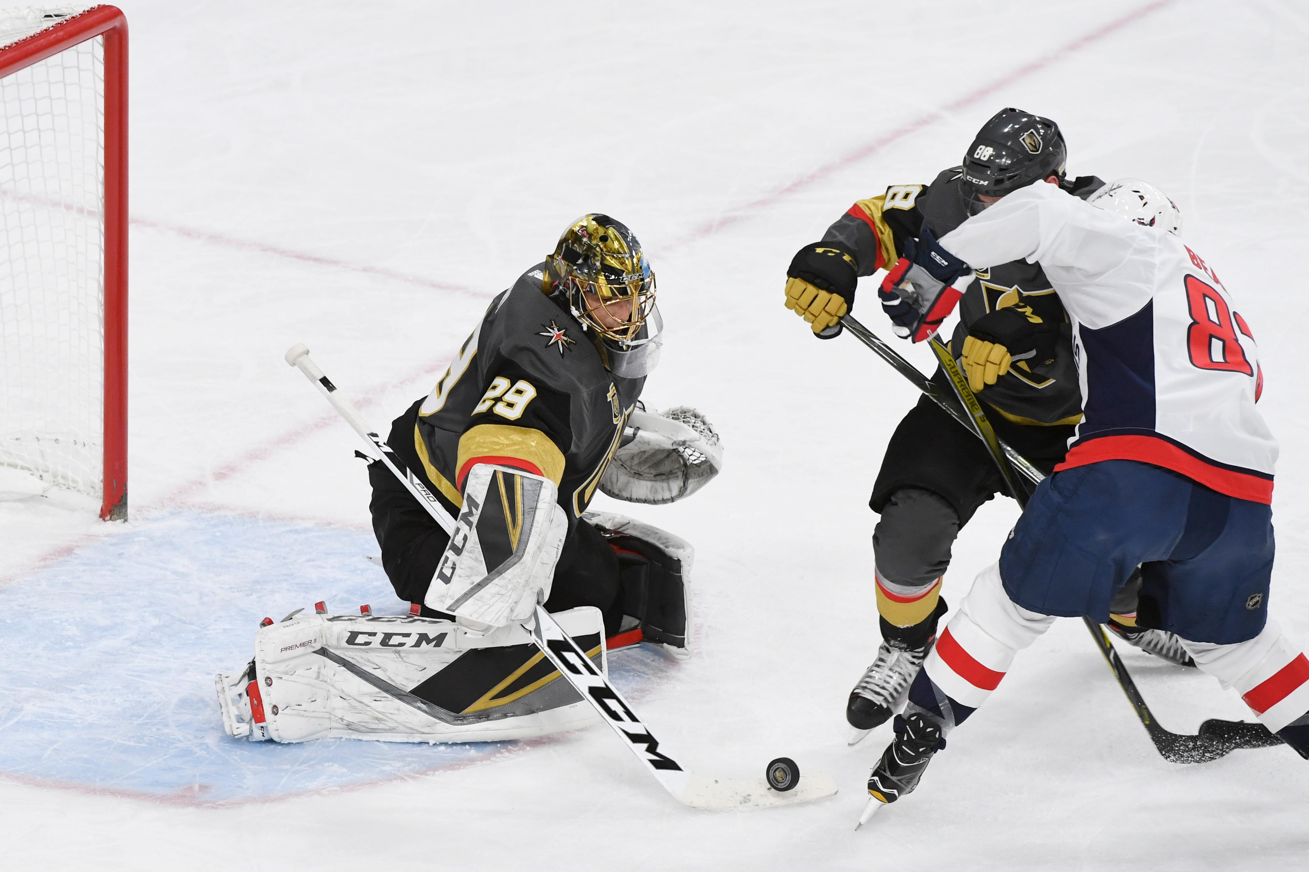 Vegas Golden Knights goalie Marc-Andre Fleury (29) stops a shot by Washington Capitals center Jay Beagle (83) during their NHL hockey game Saturday, December 23, 2017, at T-Mobile Arena in Las Vegas.  CREDIT: Sam Morris/Las Vegas News Bureau