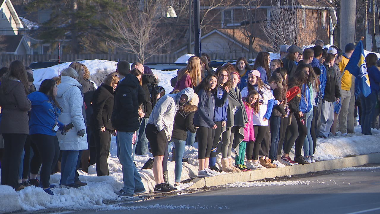 Hundreds lined Cooper Road outside Irondequoit High School to cheer on the state champion Eagles as they returned home Sunday.