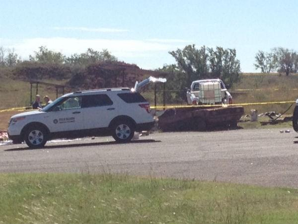 The medical examiner is on scene at Foss Lake a day after authorities pulled two vehicles from the Custer County lake.