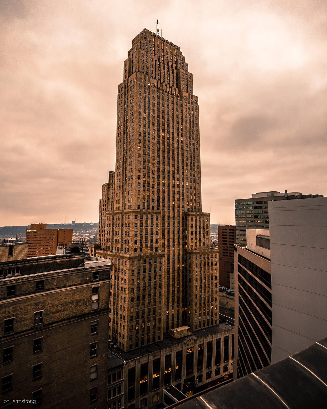 Image: IG user @cincyphil / Post: I stood atop the former Union Trust to glimpse the Carew from an angle I've never seen before. Three exposures had to be combined because I couldn't fit it all into a single frame (hence the distortion). That's how huge that thing is. // Published: 12.17.16