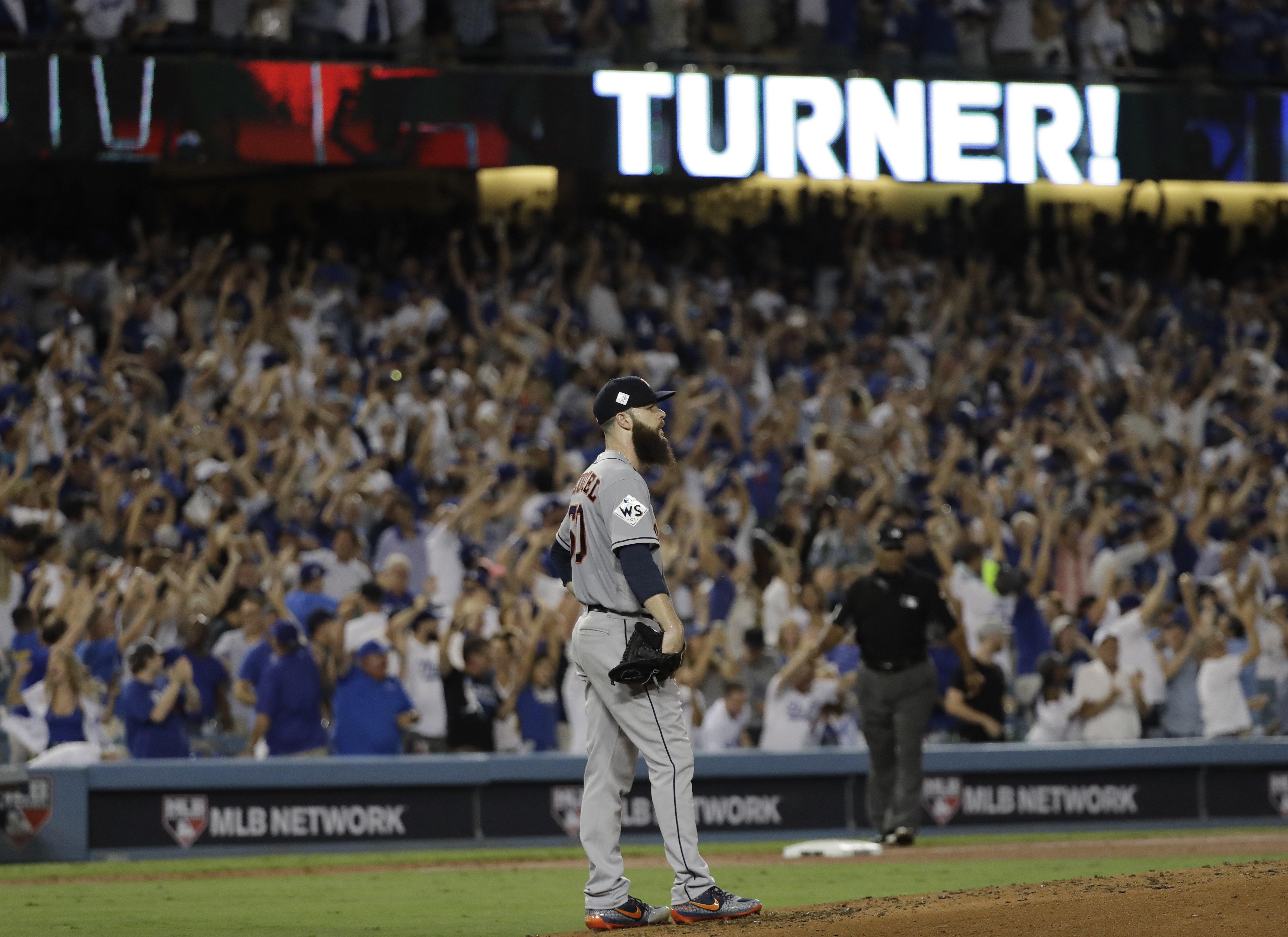 Houston Astros starting pitcher Dallas Keuchel- reacts after giving up a two-run home run to Los Angeles Dodgers' Justin Turner during the sixth inning of Game 1 of baseball's World Series Tuesday, Oct. 24, 2017, in Los Angeles. (AP Photo/David J. Phillip)