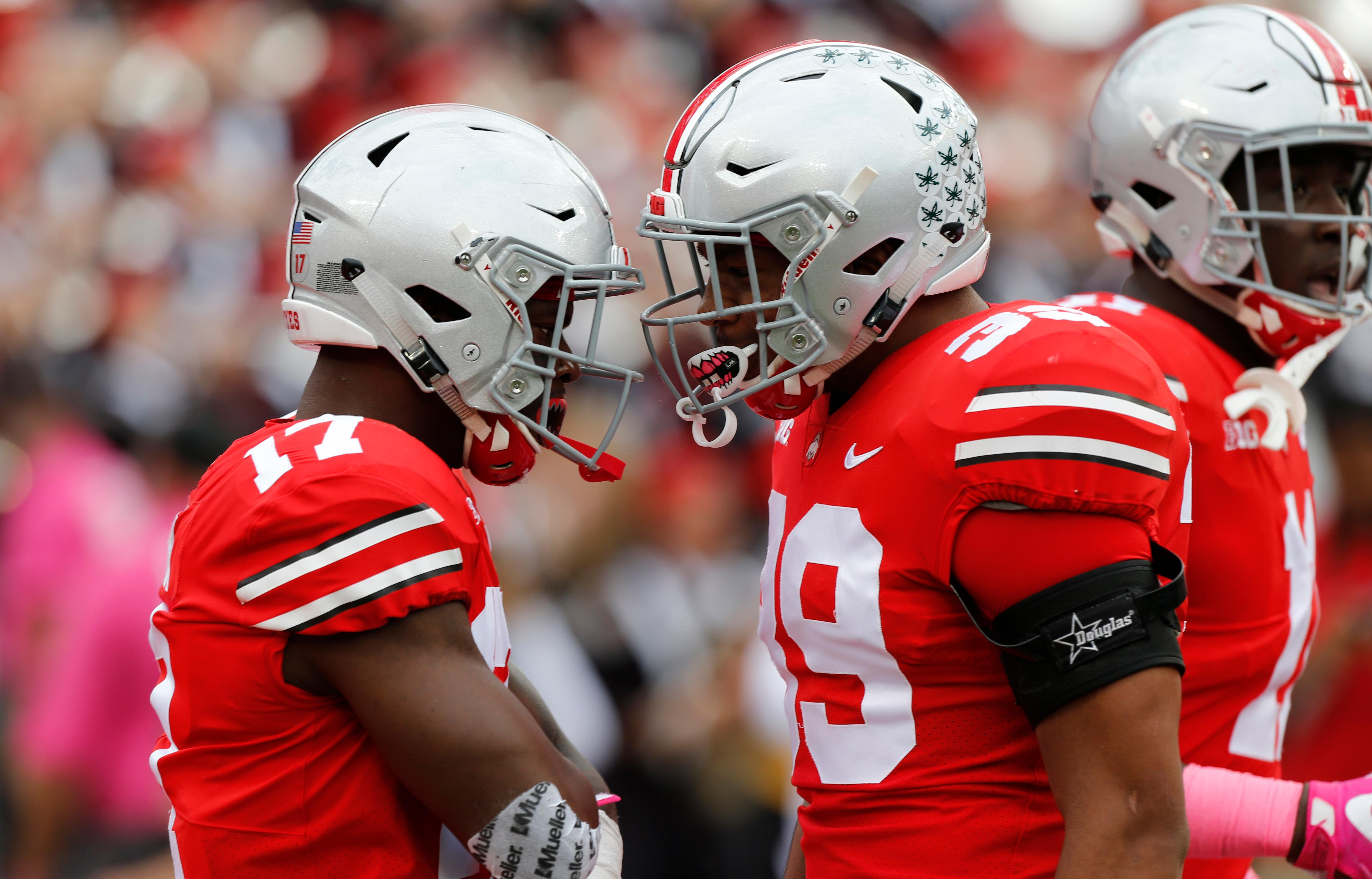 Ohio State linebacker Jerome Baker, left, celebrates recovering a fumble against Maryland with teammate linebacker Malik Harrison during the first half of an NCAA college football game Saturday, Oct. 7, 2017, in Columbus, Ohio. (AP Photo/Jay LaPrete)