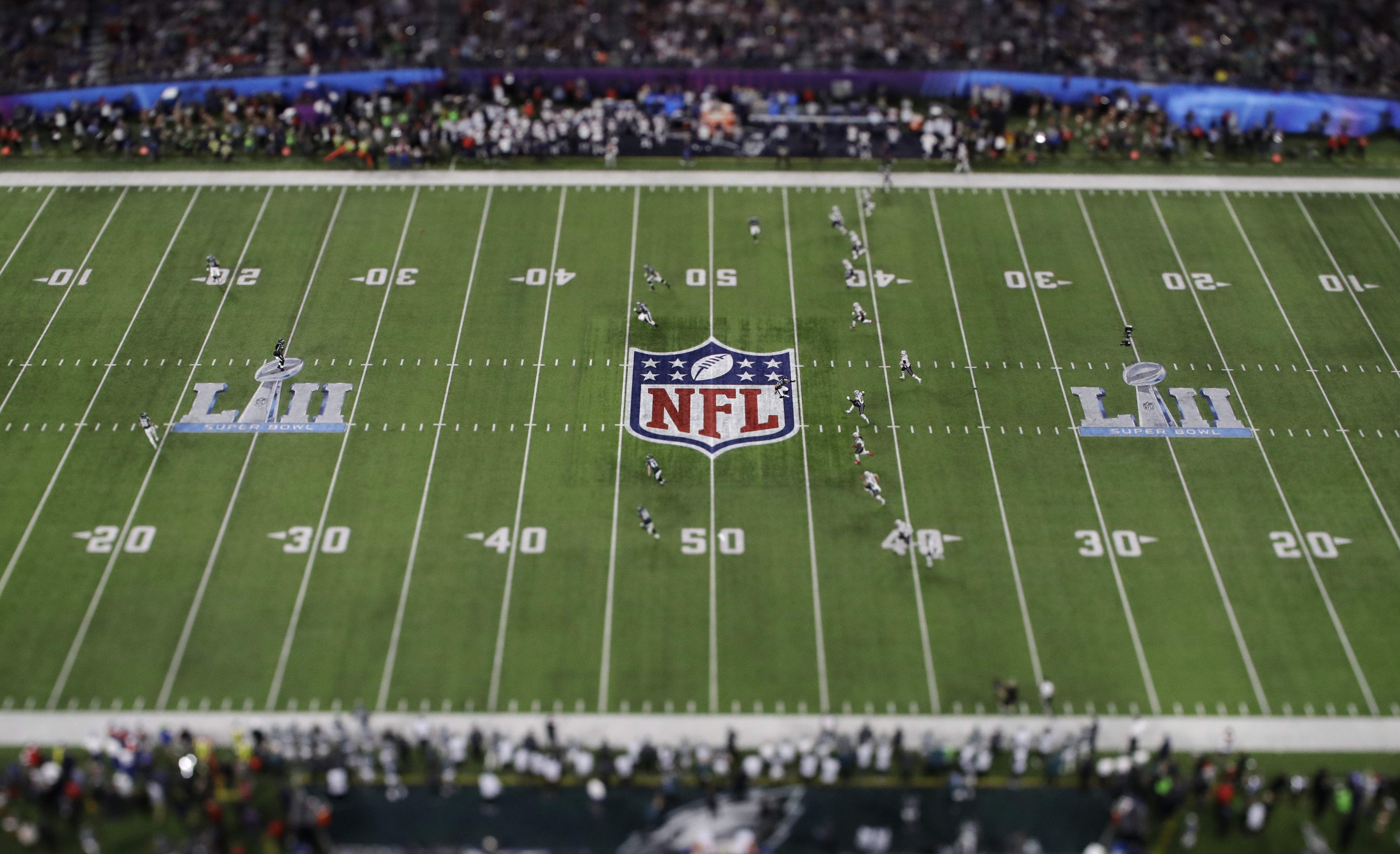 In this picture made with a specialty lens the New England Patriots kick off to the Philadelphia Eagles during the first half of the NFL Super Bowl 52 football game Sunday, Feb. 4, 2018, in Minneapolis. (AP Photo/Matt Slocum)