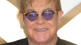 Elton John halts concert after getting smacked in the mouth by beaded necklace
