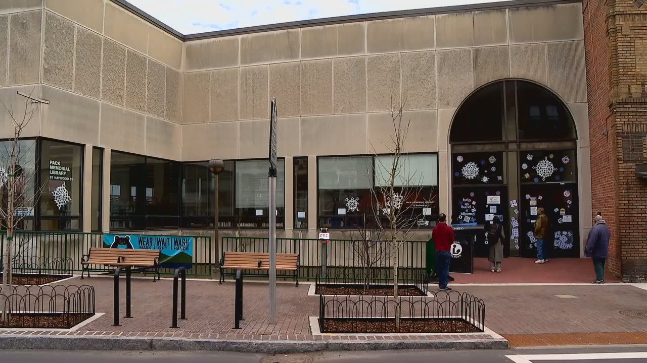 Downtown Asheville's Pack Memorial Library has reopened at 50 percent capacity with limited hours and services. (Photo credit: WLOS staff)