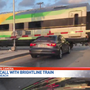 'He's trapped:' Driver has close call with Brightline train in Delray Beach