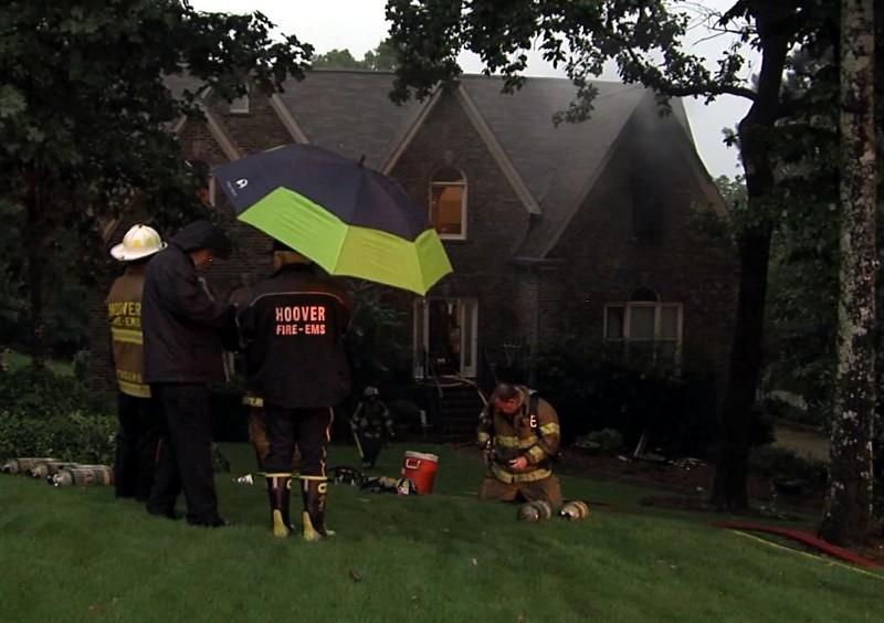 Hoover Fire and Rescue at a house fire that was sparked by lightning Wednesday.