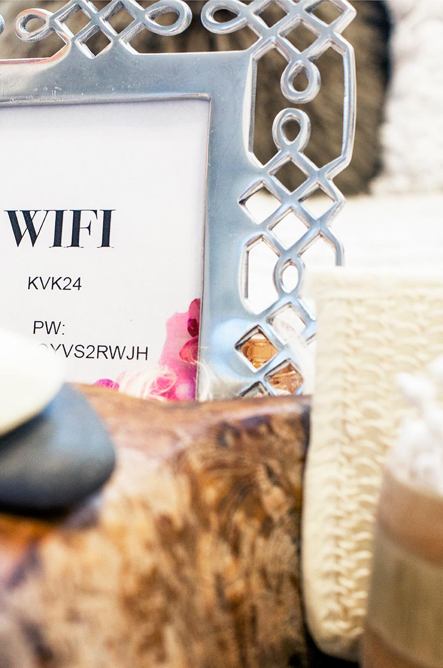 Use a cute frame to display a sheet of paper with your wifi code and password. Practical and decorative! (Image: Ashley Hafstead)