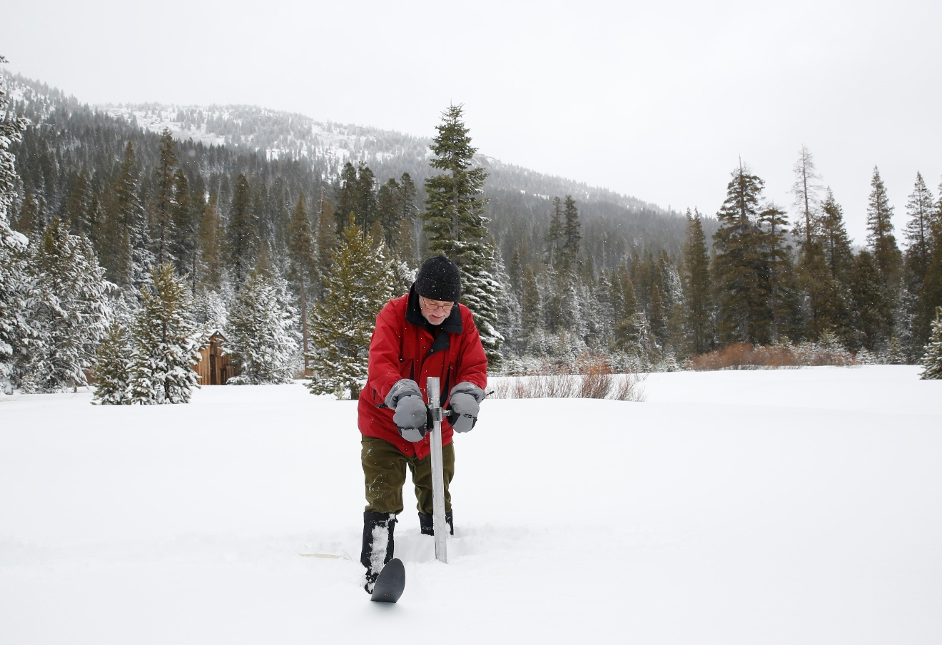 FILE - In this Jan. 3, 2017, file photo, Frank Gehrke, chief of the California Cooperative Snow Surveys Program for the Department of Water Resources, plunges the survey tube into the snowpack as he conducts the first snow survey of the season at Phillips Station near Echo Summit, Calif.  More than 40 percent of California has emerged from a punishing drought that covered the whole state a year ago, federal drought-watchers said Thursday, Jan. 12,   a stunning transformation caused by an unrelenting series of storms in the North that filled lakes, overflowed rivers and buried mountains in snow. (AP Photo/Rich Pedroncelli, File)