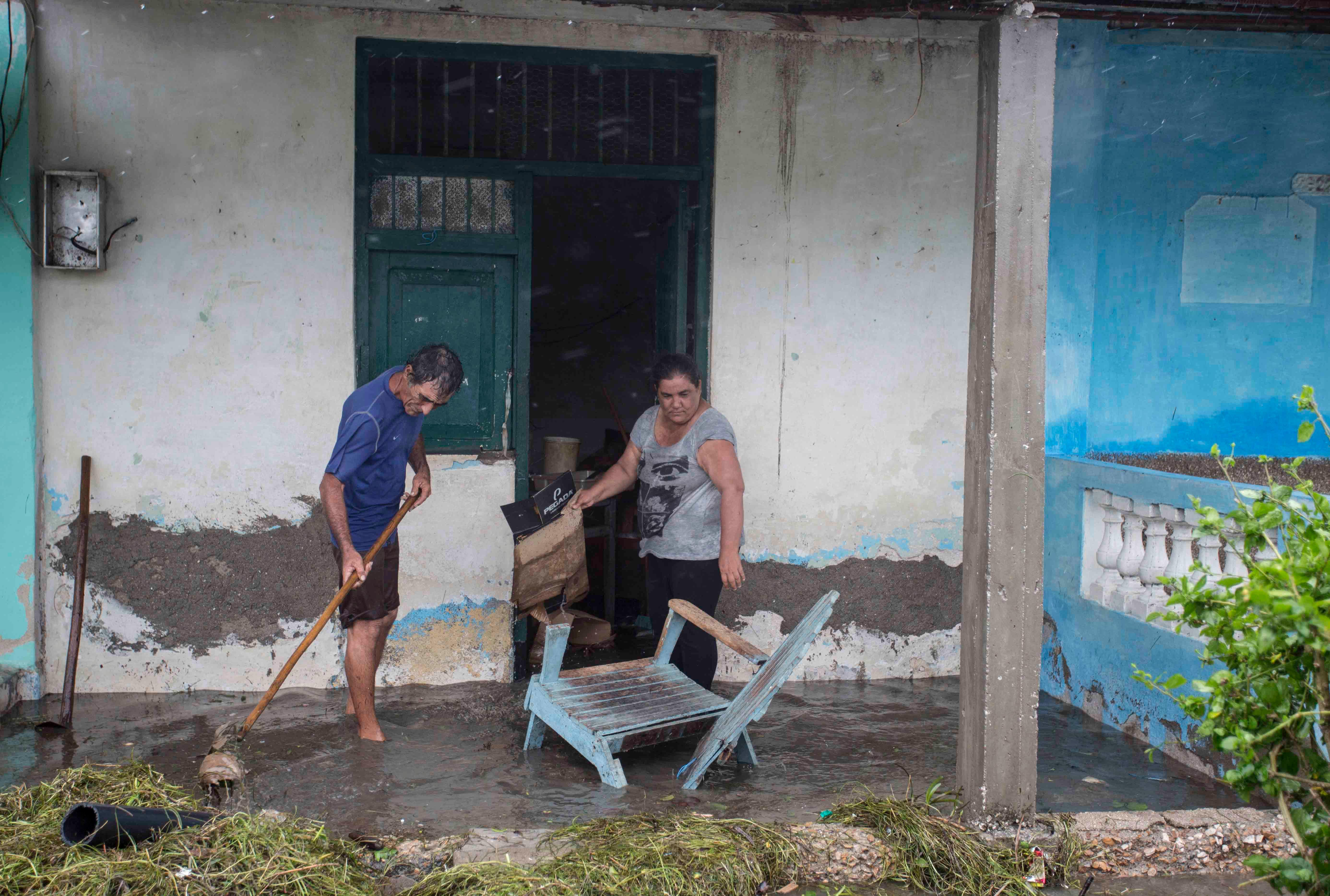 Residents begin the task of cleaning their flooded homes in the aftermath of Hurricane Irma, in Caibarien, Cuba, Saturday, Sept. 9, 2017. There were no reports of deaths or injuries after heavy rain and winds from Irma lashed northeastern Cuba. Seawater surged three blocks inland in Caibarien. (AP Photo/Desmond Boylan)