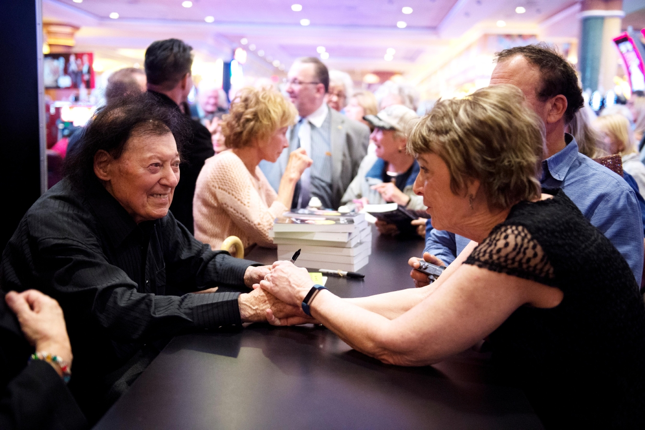 Comedian Marty Allen greets a fan after performing for his 95th birthday with a show at the South Point Thursday, March 23, 2017. [Sam Morris/Las Vegas News Bureau]