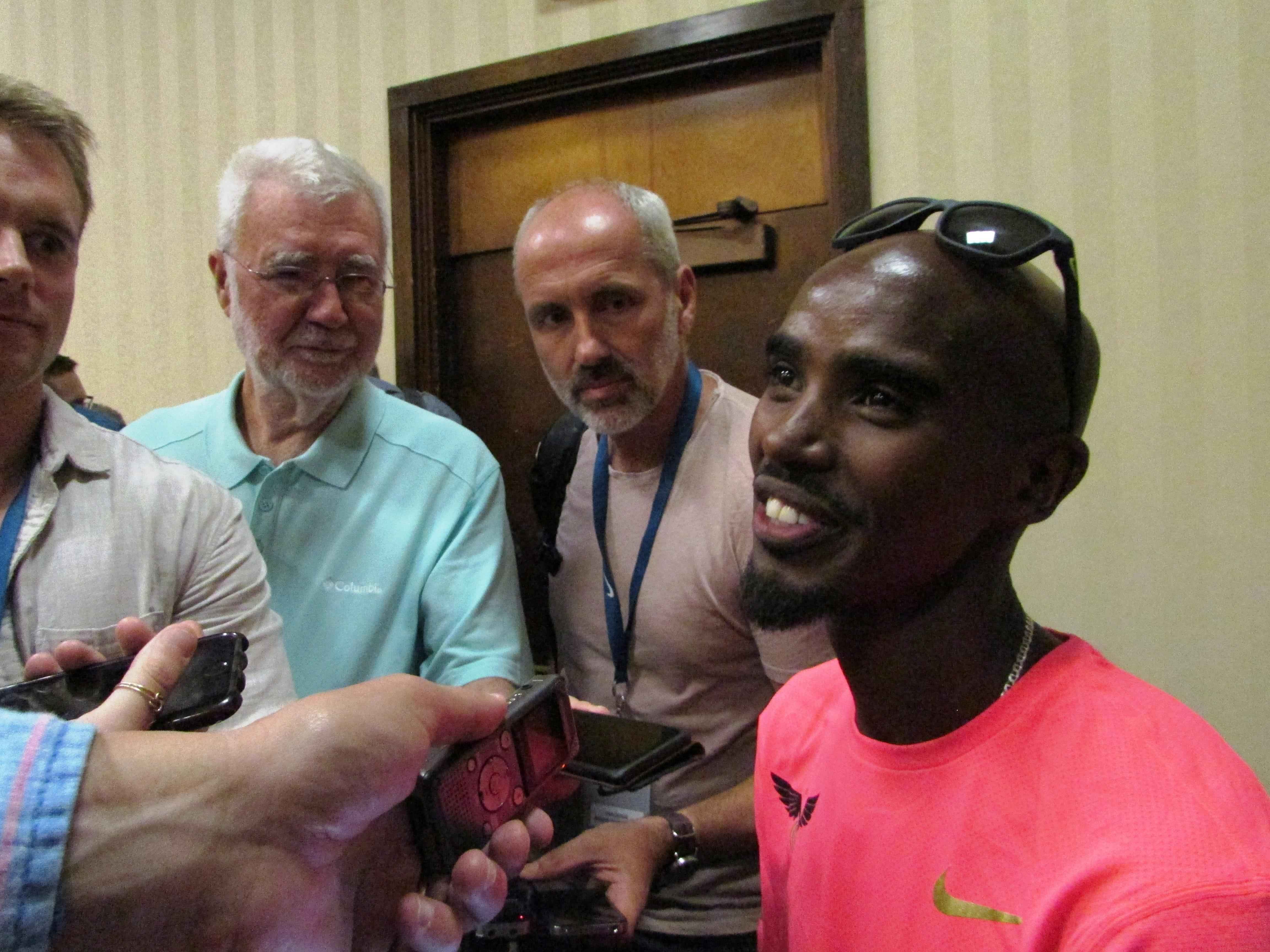 Olympic gold medalist Mo Farah speaks to reporters Friday, May 26, 2017, in advance of the Prefontaine Classic track meet in Eugene, Ore. Farah plans to run in the 5,000 meters. (AP Photo/Anne M. Peterson)