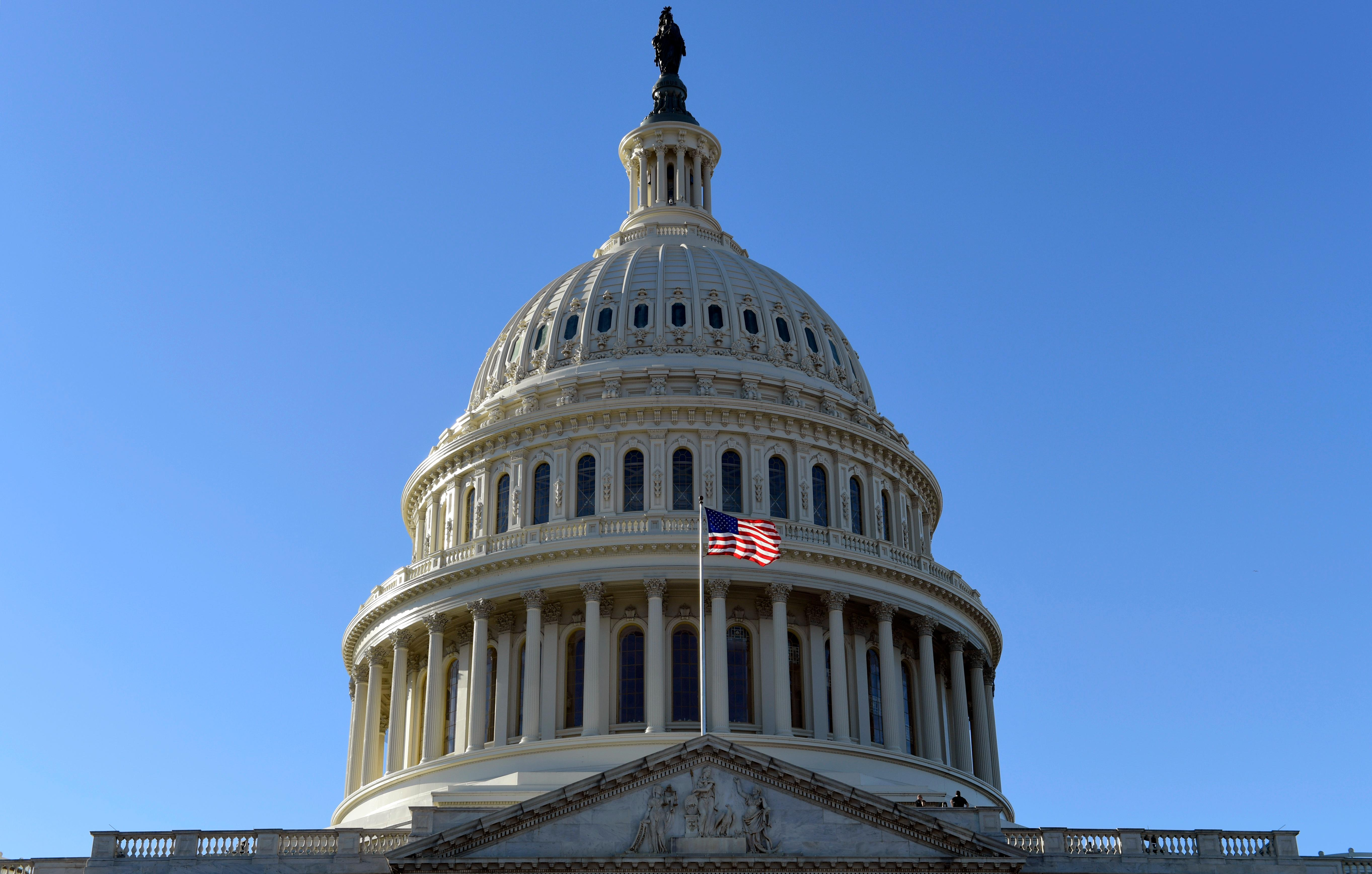 A flag flies on at the U.S. Capitol in Washington, Tuesday, Nov. 28, 2017. The House is scheduled to vote on adopting mandatory anti-sexual harassment training for all members and their staff. The vote comes amid a wave of allegations of sexual misconduct against lawmakers that has thrust the issue of gender hostility and discrimination on Capitol Hill squarely into the spotlight. (AP Photo/Susan Walsh)