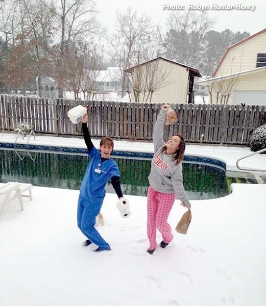 "The ""Snow Girls"" are safe in Hokes Bluff, Ala., Tuesday, January 28, 2014."