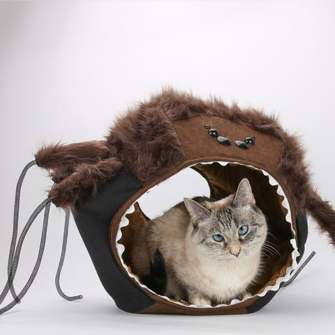 <p>Give your cat a spooky place to curl up out of the holiday noise. The spider Cat Ball® cat bed is a novelty version of their standard bed with brown grizzly bear fur, silly bouncy legs and creepy spider eyes. This slightly smaller bed fits cats and dogs up to 18 lbs and is made of 23% acrylic, 77% polyester with a 100% cotton lining. The beds are also machine washable. Find out more at The Cat Ball thecatball.com. (Image: The Cat Ball)</p><p></p>