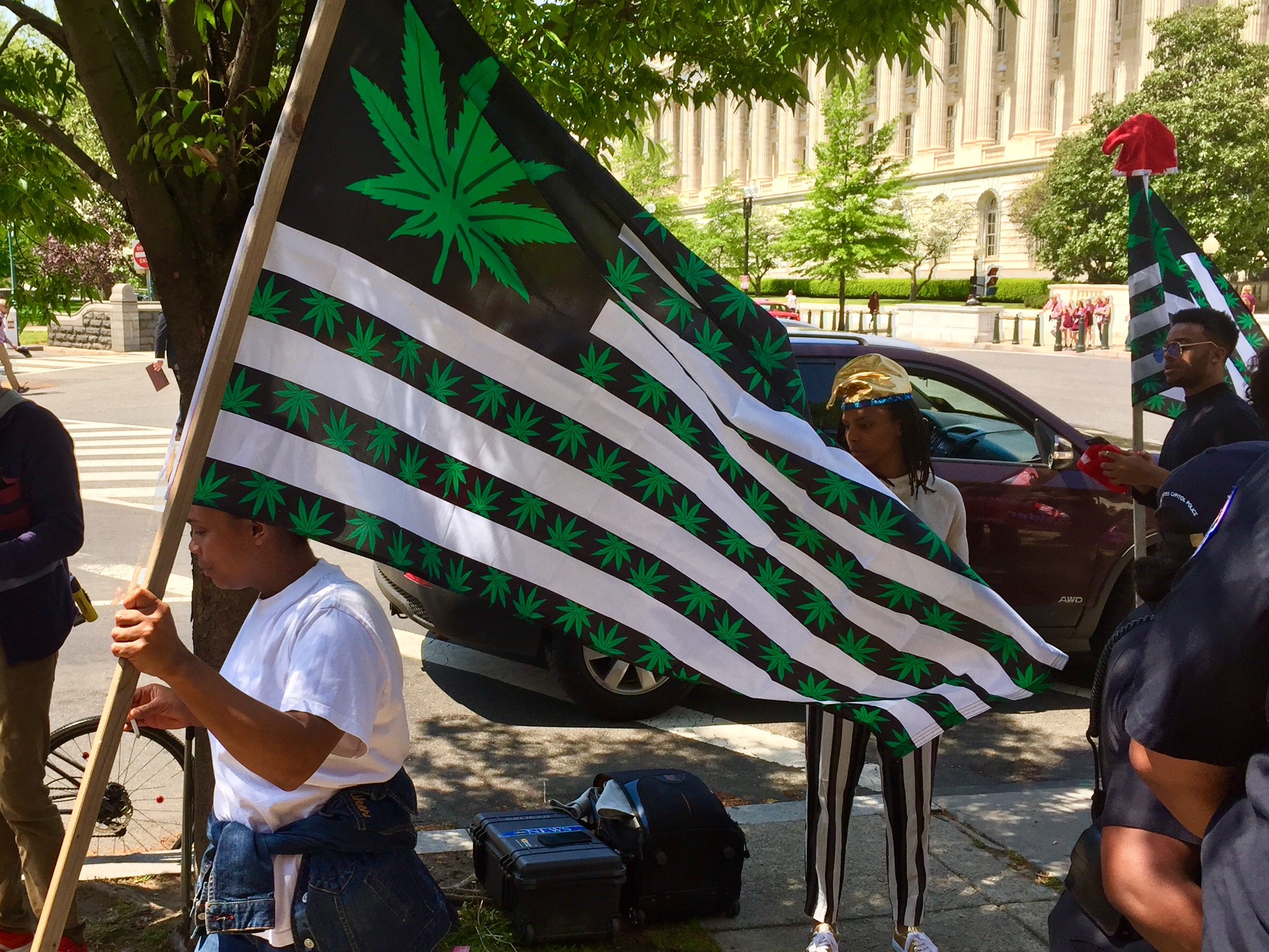 "FILE photo shows marijuana activists holding a ""4/20"" demonstration to legalize marijuana outside the U.S. Capitol on April 20, 2017. Washington, D.C. is one of eight local jurisdictions that has legalized marijuana for adults, but it is still prohibited under federal law and on federal property in the District. (Photo credit: Sinclair Broadcast Group)"