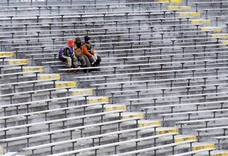Fans sit in their seats at Lambeau Field before an NFL wild-card playoff football game between the Green Bay Packers and the San Francisco 49ers, Sunday, Jan. 5, 2014, in Green Bay, Wis.