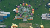 2 women, child injured after falling more than 15 feet from Ferris wheel