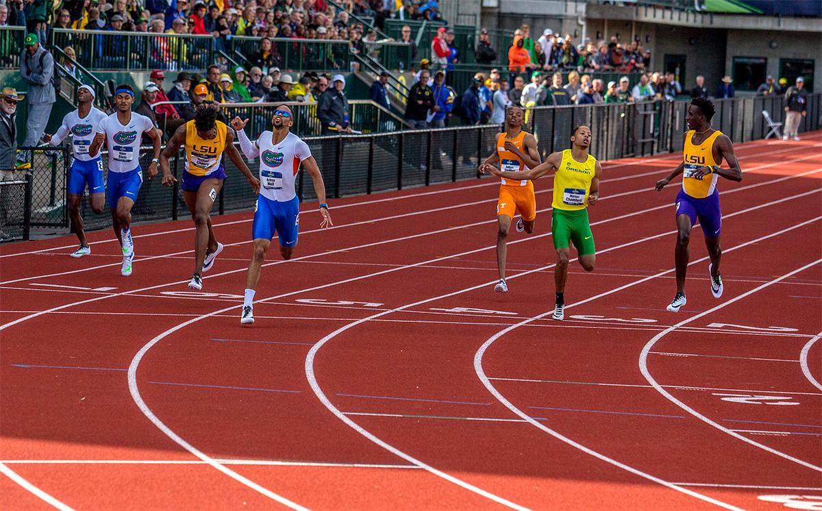 Florida's Arman Hall hits the line in the 400 meter dash. Hall won the race in 44.82. Photo by August Frank, Oregon News Lab