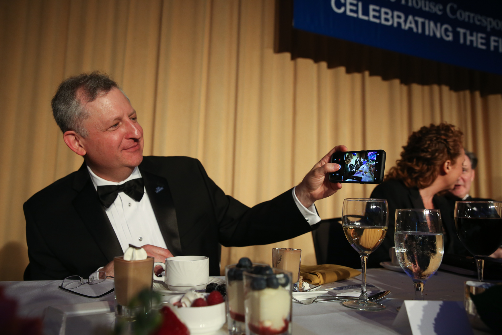 Todd J. Gillman , the Washington bureau chief of The Dallas Morning News, snaps a photo at the White House Correspondents' Dinner.{ }(Amanda Andrade-Rhoades/DC Refined)