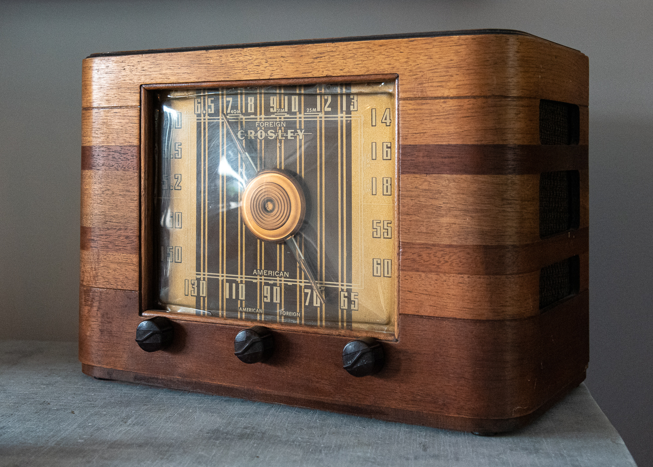 His house is filled with art and artifacts from Cincinnati's past, including things like a painting by a former Rookwood Pottery artist and old jars from Christian Moerlein's brewery. Crosley radios are among his collection. / Image: Phil Armstrong, Cincinnati Refined // Published: 5.31.19