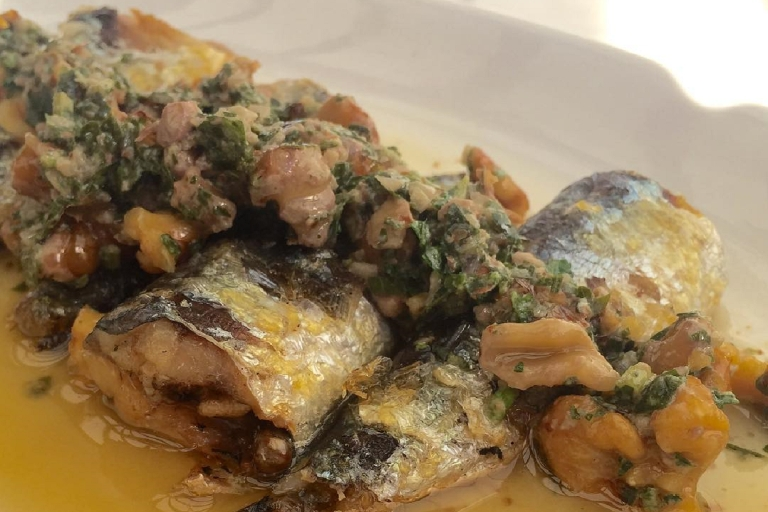 Sardines are excellent when grilled, and Ballard standby The Walrus and the Carpenter highlights this delicious fact in their dish of grilled sardines, walnuts, parsley, and shallots. (Image Courtesy: The Walrus and the Carpenter Facebook Page)