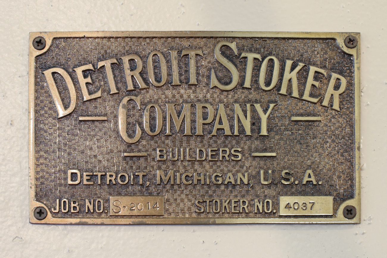 A plaque from the Detroit Stoker Company lines a historic fire door preserved in the property.{&nbsp;}/ Image: Ronny Salerno // Published: 2.6.19<p></p>