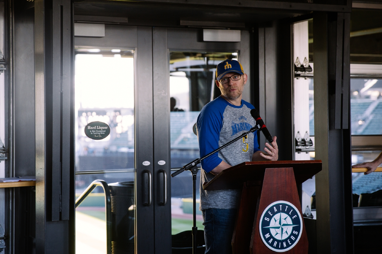 Ethan Stowell, decked out in Mariners gear, talks about the new menu (Image: Joshua Lewis/Seattle Refined).