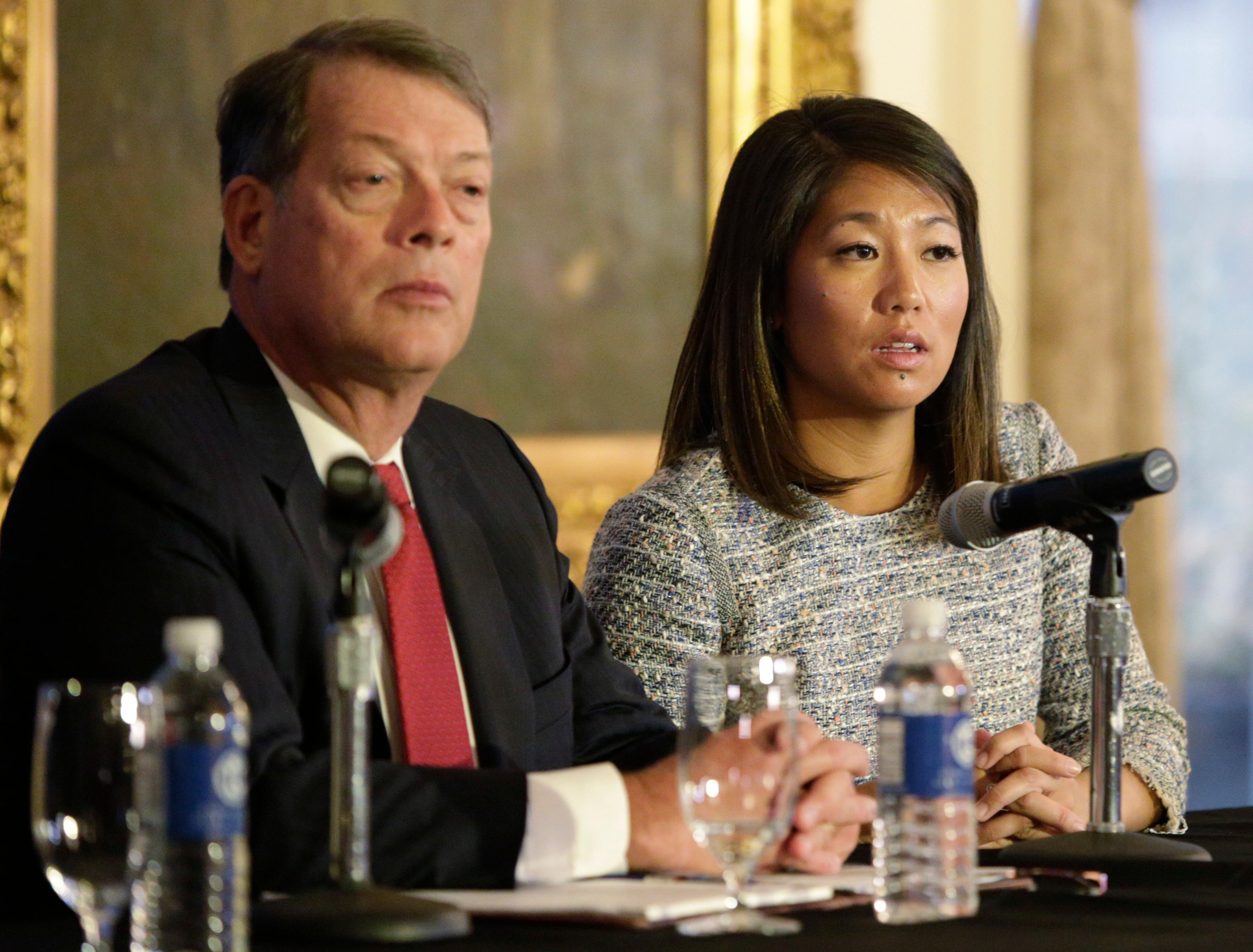 "Crystal Pepper daughter of Dr. David Dao accompanied by attorney Stephen Golan, speaks at a news conference Thursday, April 13, 2017, in Chicago. Dao a passenger dragged from a United Express flight Sunday April 9, 2017, suffered a ""significant"" concussion and broken nose, and he lost two front teeth, attorney Thomas Demetrio said Thursday. Dao was removed from the plane after he refused to give up his seat on the full flight from Chicago to Louisville to make room for four crew members. (AP Photo/Teresa Crawford)"