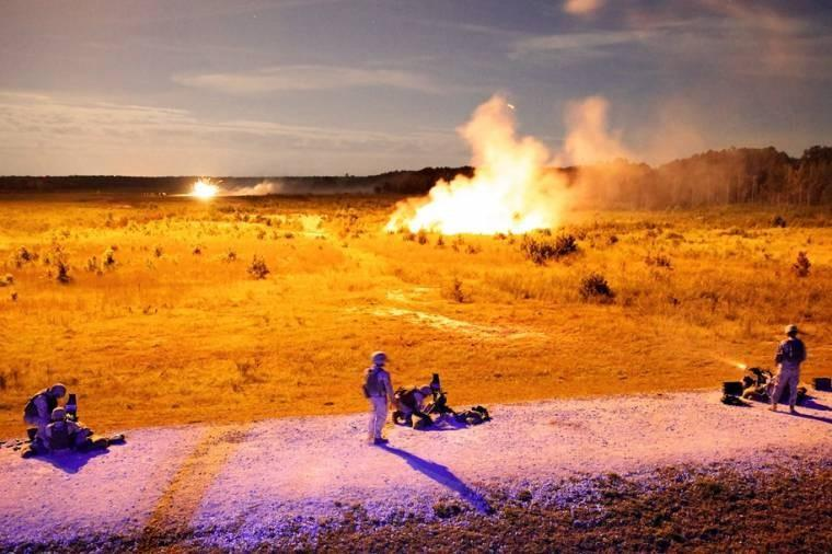 Marines fire Mk. 19 grenade launchers as part of a grenade training exercise at night on Camp Lejeune, N.C. The Marines waited for illumination flares to light the range before firing on targets.