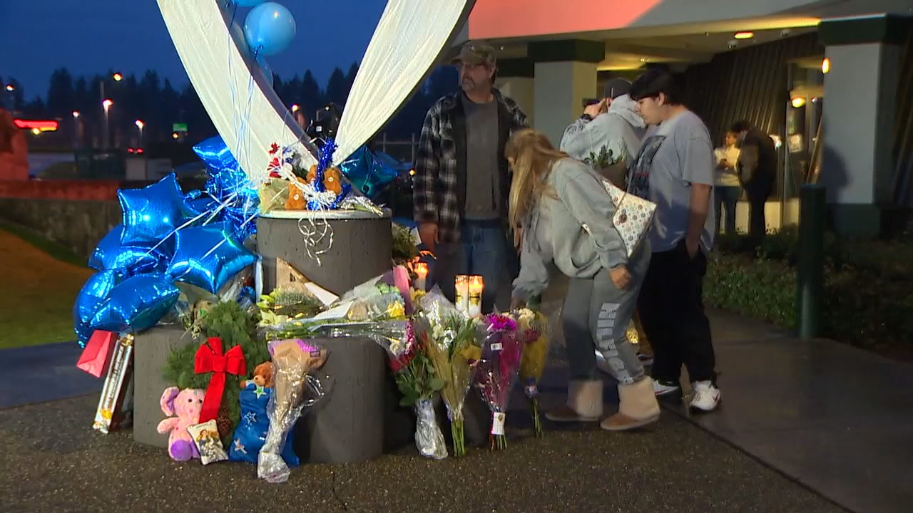 A tribute for fallen Deputy Daniel McCartney continued to grow outside the Pierce County Hill Precinct  in Puyallup Monday night.  (Photo: KOMO News)